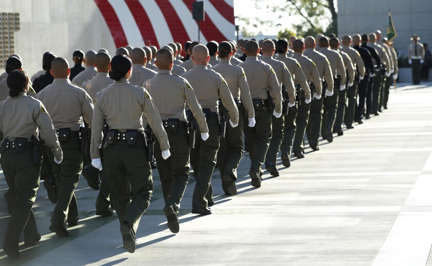 Los Angeles County sheriff's deputies march in formation at their graduation ceremony in 2017.