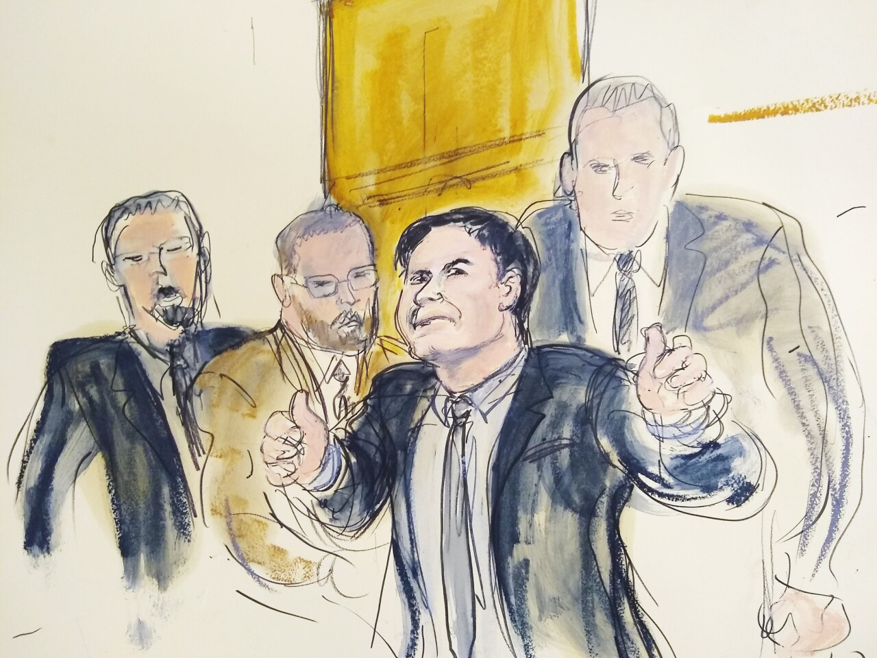 """Joaquin """"El Chapo"""" Guzman gestures """"thumbs up"""" to his wife as U.S. marshals remove him from the courtroom after he was found guilty of drug-trafficking in New York."""