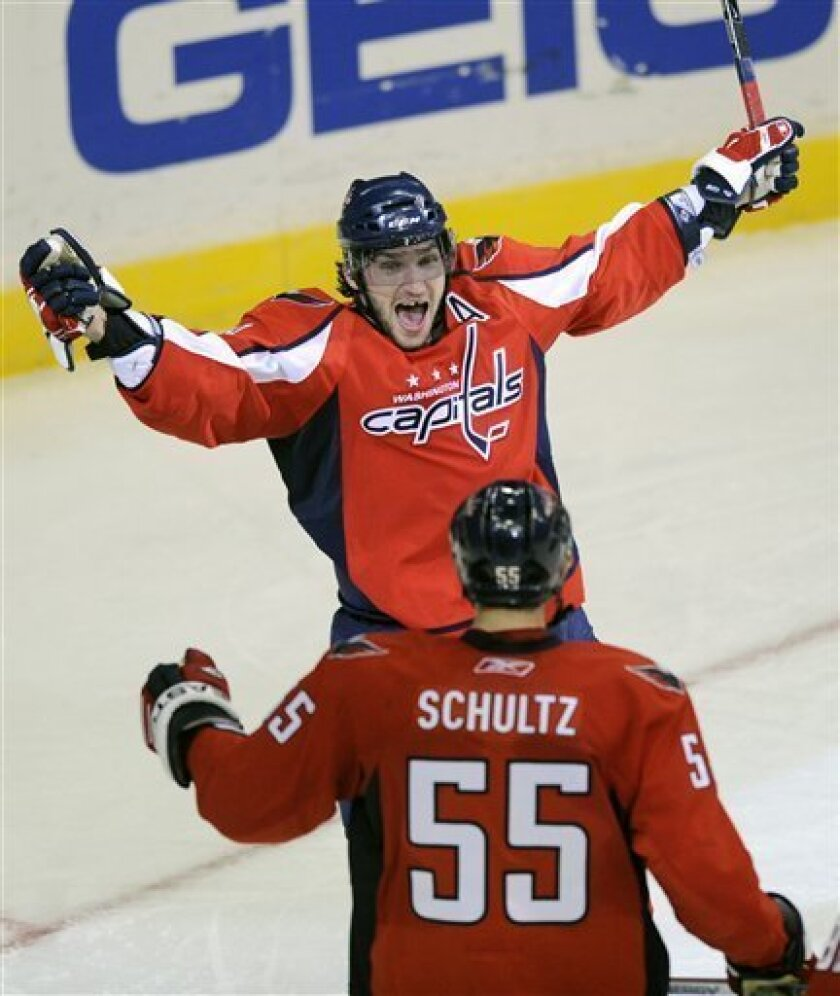 Washington Capitals' Alex Ovechkin, top, of Russia celebrates his goal with teammate Jeff Schultz (55) during the third period of an NHL hockey game against the Detroit Red Wings, Saturday, Jan. 31, 2009, in Washington. The Capitals won 4-2. (AP Photo/Nick Wass)
