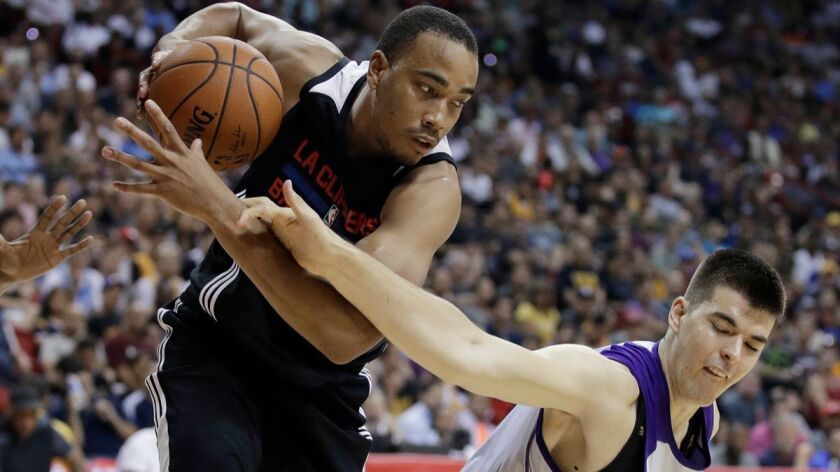 Los Angeles Clippers' Brice Johnson, left, pulls the ball away fom Los Angeles Lakers' Ivica Zubac d