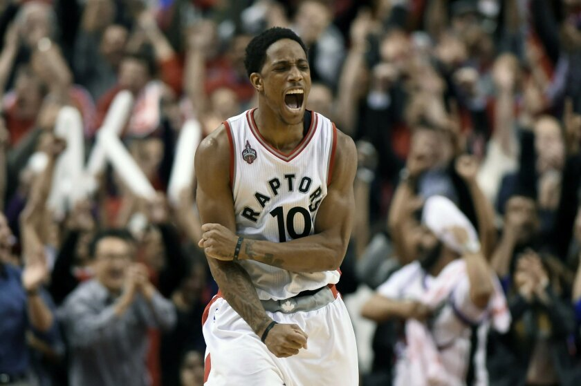 FILE - In this April 26, 2016, file photo, Toronto Raptors' DeMar DeRozan (10) celebrates his three-pointer to take the lead against the Indiana Pacers during the second half of Game 5 of an NBA first-round playoff basketball series in Toronto. Toronto's DeMar DeRozan, Atlanta's Al Horford, Memphis