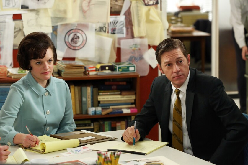 """Elisabeth Moss, left, plays Peggy Olson on """"Mad Men."""" She is seen in a scene with Kevin Rahm."""