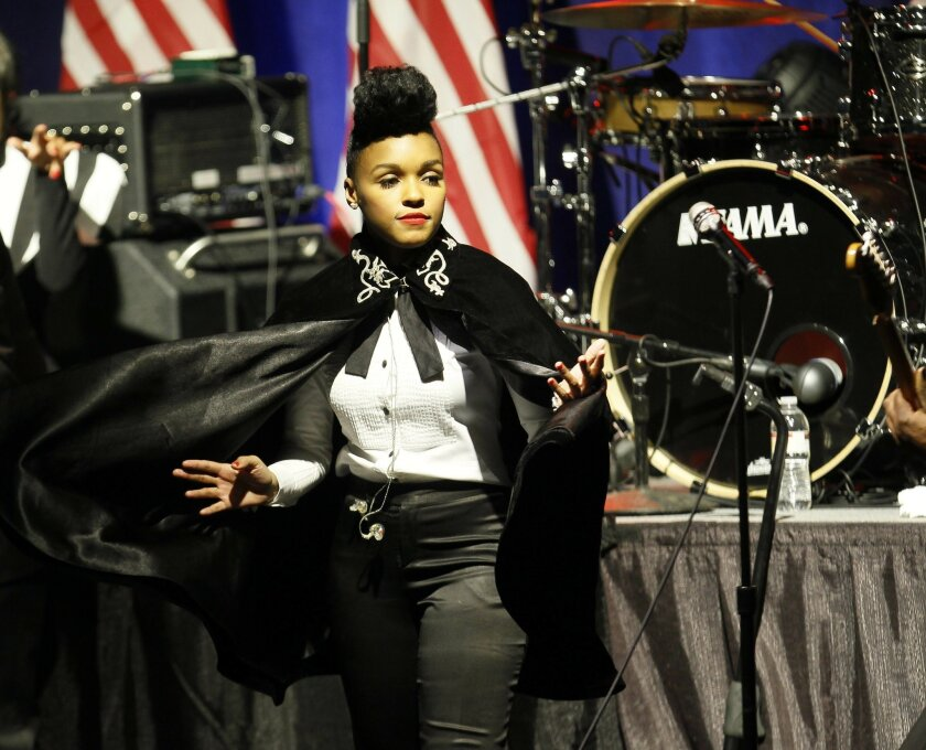 In this photo taken Jan. 11, 2012 file photo, singer-songwriter Janelle Monae performs during a campaign event for President Barack Obama, in Chicago. Monae and rapper Kendrick Lamar will help President Barack Obama celebrate his final Fourth of July at the White House. (AP Photo/Charles Rex Arboga
