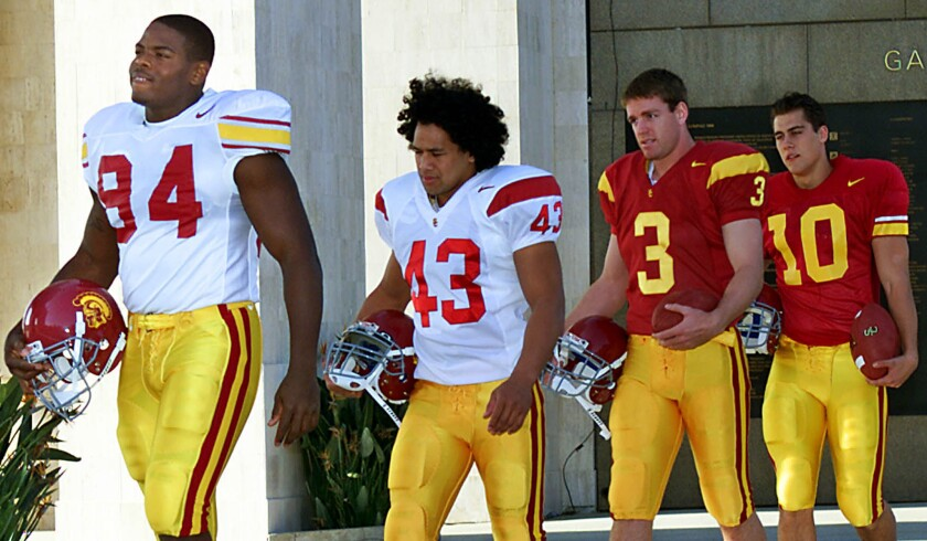 In 2002, USC unveiled new football jerseys with four future NFL players -- from left, Kenechi Udele, Troy Polamalu, Carson Palmer and Matt Cassel. It was the first change since 1971.