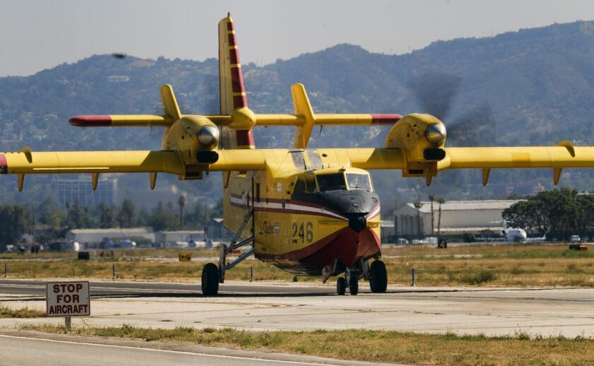 """One of two """"super scooper"""" firefighting aircraft arrive arrive on lease from Quebec at the Van Nuys airport in Los Angeles on Saturday. The large water tankers, which can carry up to 1,600 gallons of water, arrived nearly a month earlier than usual."""