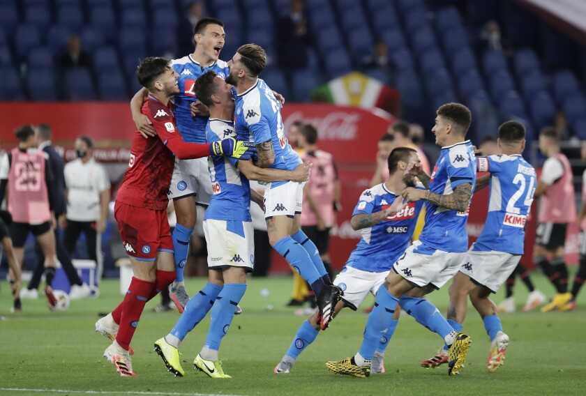 Napoli players celebrate after winning the Italian Cup soccer final match between Napoli and Juventus, at Rome's Olympic Stadium, Wednesday, June 17, 2020. (AP Photo/Andrew Medichini)
