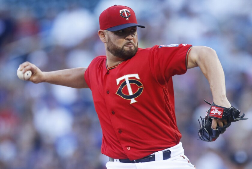 Ricky Nolasco, above, moves from Minnesota to the Angels, who sent Hector Santiago to the Twins in a four-pitcher trade.
