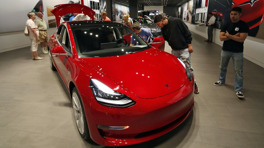 A Model 3 on display in a Tesla showroom in the Cherry Creek Mall in Denver in July.