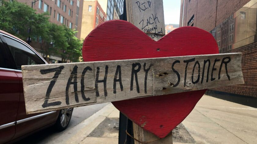 A makeshift cross marks the spot where Zachary Stoner was killed last year in a drive-by shooting in downtown Chicago.