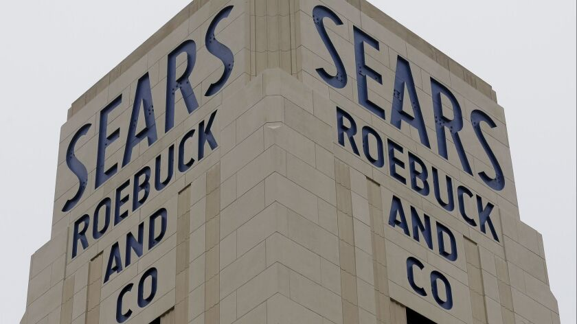 FILE- In this Jan. 8, 2019, file photo an American flag flies above a Sears store in Hackensack, N.J