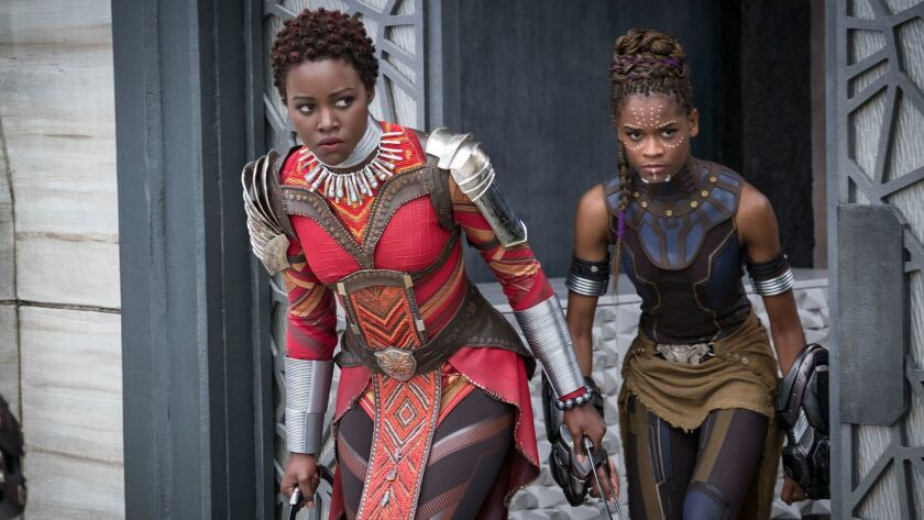 "Don't look now. Lupita Nyong'o (left) and Letitia Wright are stealing away with Marvel Studios' ""Black Panther."""
