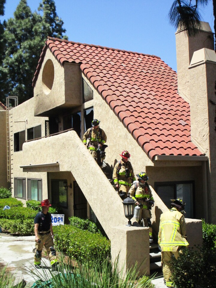 Firefighters exiting the apartment.