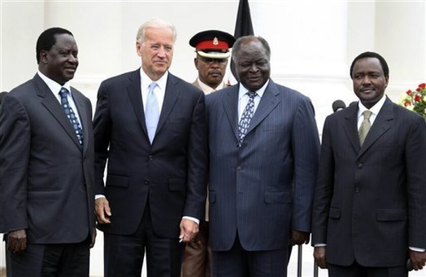 U.S. Vice President Joe Biden, second left, pose for photographers with Kenyan Prime Minister Raila Odinga, left, Kenyan President Mwai Kibaki, third left, and Kenyan Vice President Kalonzo Musyoka, right, at State House Nairobi, Kenya Tuesday June 8, 2010. Biden began his three-African nation tour in Egypt and are scheduled to visit Nairobi National Park to view wildlife before traveling to South Africa for the opening of football's World Cup later in the week. (AP Photo/Sayyid Azim)