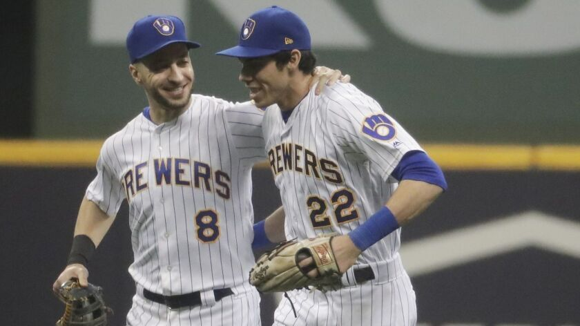 Milwaukee Brewers' Ryan Braun and Christian Yelich celebrate after a baseball game against the Detro