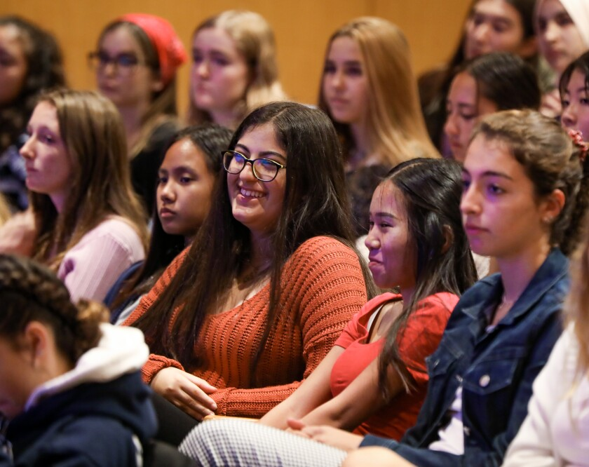 San Diego Unified School District high school students listen as Karen Nelson, president of the J. Craig Venter Institute, speaks at the Salk Institute about her scientific career.