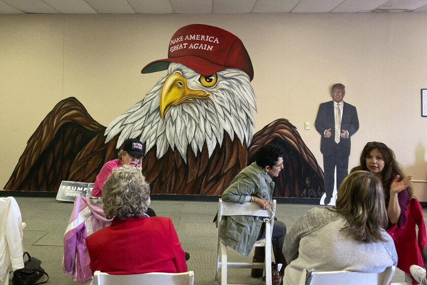 Women who support President Donald Trump gather at a campaign meet-up in Canton, Ohio, on Monday, Oct. 5, 2020, to rally for Trump's campaign in the bellwether state. Trump's supporters are not shocked that he caught COVID-19. Some are praising him because he managed to dodge it so long and think it might help his reelection. Very few think he needs to reevaluate his approach to the deadly virus. (Farnoush Amiri)