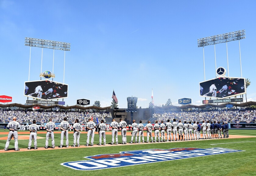 The San Diego Padres line up during introductions before opening day at Dodger Stadium on April 6.