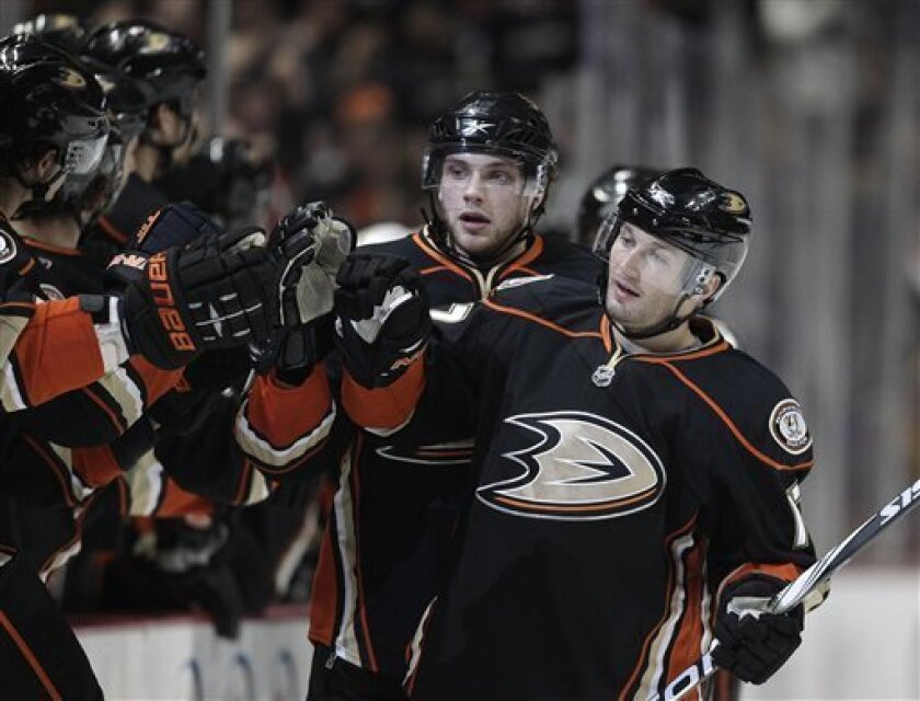 Anaheim Ducks defenseman Lubomir Visnovsky, right, of Slovakia, and teammate Bobby Ryan are greeted by  teammates after Visnovsky scored against the Dallas Stars in the first period of an NHL hockey game in Anaheim, Calif., Friday, March 4, 2011. (AP Photo/Jae C. Hong)