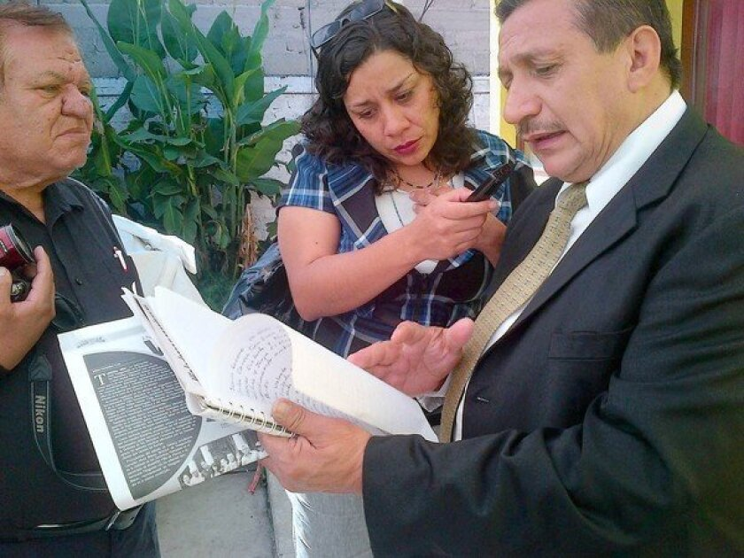Political activist David Mancera reads to reporters in Ecatepec, Mexico, the names of women slain in Mexico state.