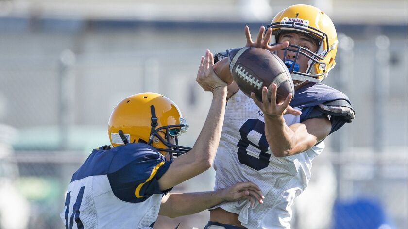 Marina's Nathan Pendleton, right, goes up for a ball during practice on Wednesday, August 8.