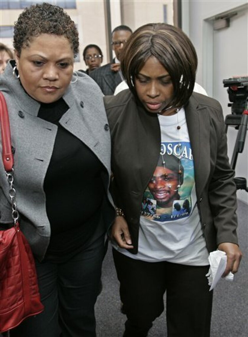 Wanda Johnson, right, mother of Oscar Grant, leaves an Oakland, Calif., courtroom, Thursday, Jan. 15, 2009 after Bay Area Rapid Transit (BART) police officer Johannes Mehserle was arraigned. Mehserle allegedly shot and killed an unarmed man, Oscar Grant, 22, while he was laying face down on a train