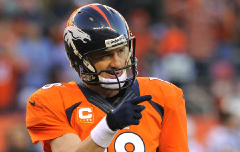 Denver quarterback Peyton Manning smiles in the closing minutes of the Broncos' 26-16 win over the New England Patriots in the AFC championship game on Sunday. The win sends the Broncos to the Super Bowl, where they'll face the Seattle Seahawks.