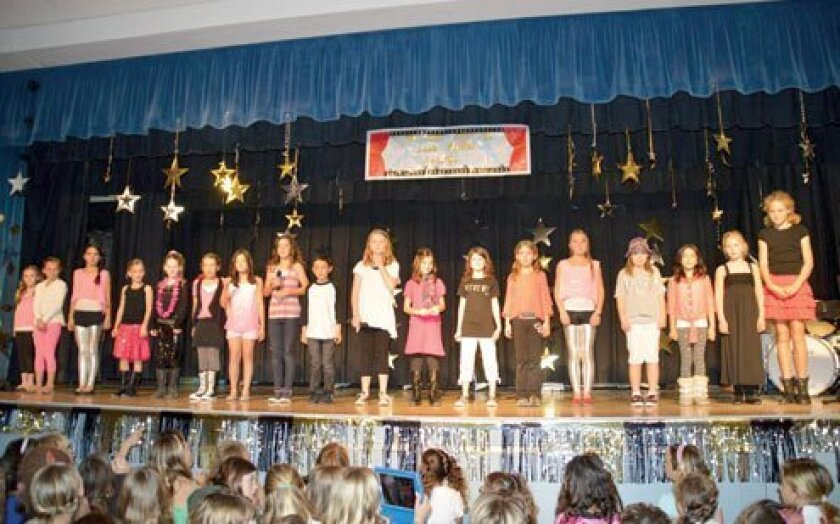 Under the direction of parent and musician Jill Nooren, the GLEEKS Club (an LJES afterschool program) perform.