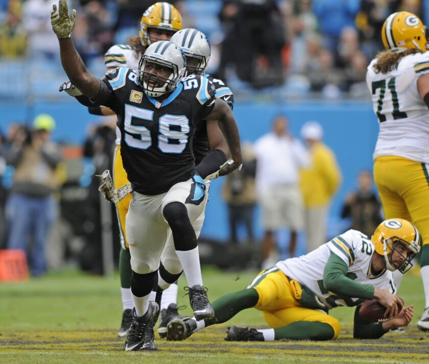 Carolina Panthers' Thomas Davis (58) celebrates after sacking Green Bay Packers' Aaron Rodgers (12) in the first half of an NFL football game in Charlotte, N.C., Sunday, Nov. 8, 2015. (AP Photo/Mike McCarn)