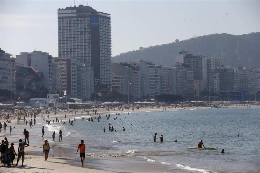 Tourists enjoy Rio de Janeiro's iconic Copacabana beach. EPA-EFE/File