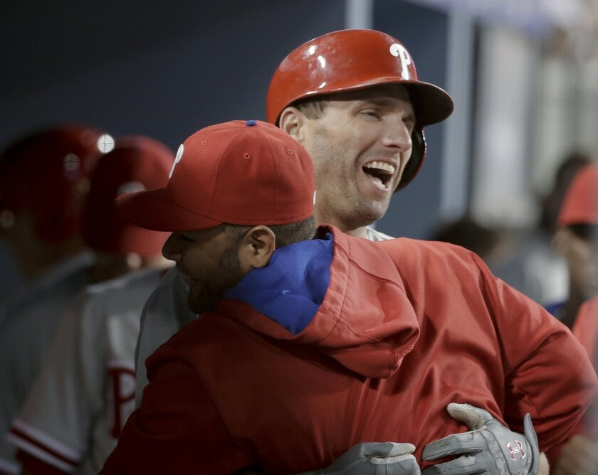 Philadelphia Phillies' Jeff Francoeur, right, celebrates his home run against the Los Angeles Dodgers during the seventh inning of a baseball game in Los Angeles, Tuesday, July 7, 2015. (AP Photo/Chris Carlson)