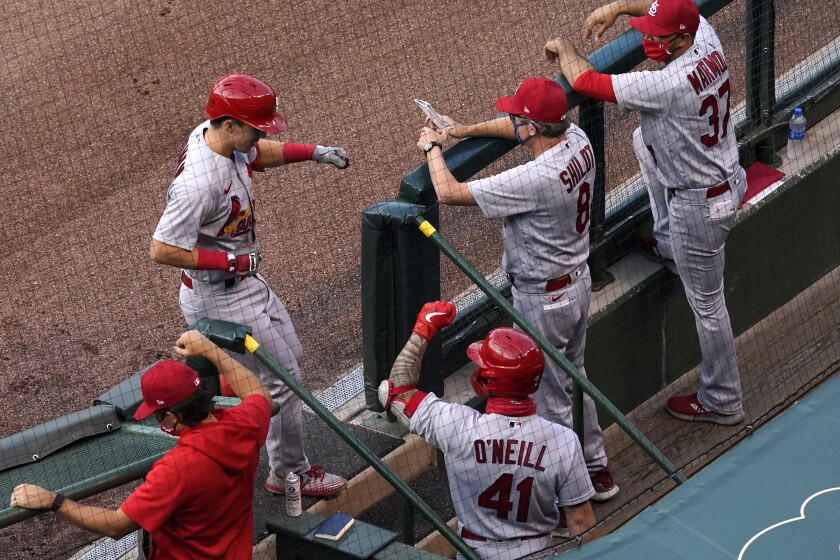 St. Louis Cardinals' Tommy Edman, left, celebrates with coaching staff members and a teammate after hitting a solo home run against the Chicago Cubs during the first inning of a baseball game in Chicago, Sunday, Sept. 6, 2020. (AP Photo/Nam Y. Huh)