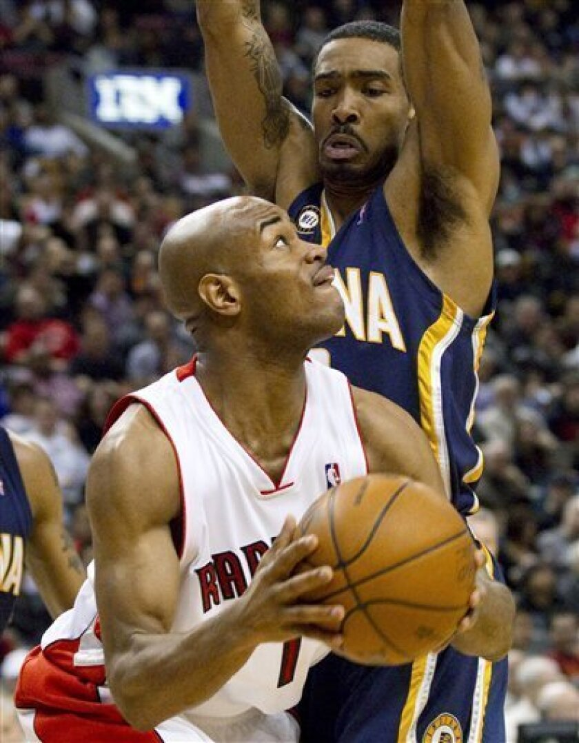 Toronto Raptors' Jarrett Jack, left, is guarded closely by Indiana Pacers' Luther Head during the first half of an NBA basketball game in Toronto on Sunday, Jan. 31, 2010. (AP Photo/The Canadian Press, Darren Calabrese)