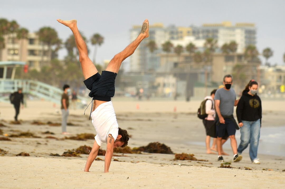 George Vouzou works out at Venice Beach on Tuesday.