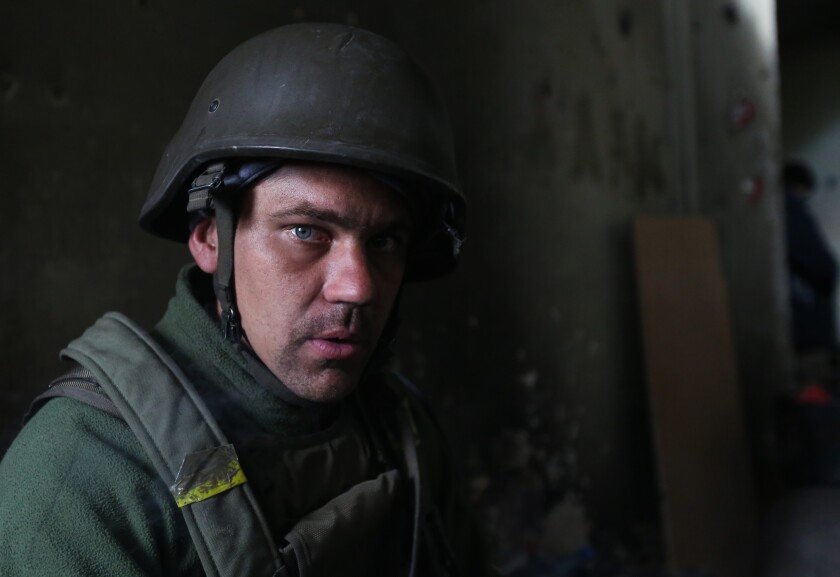 Sergei Tanasov, who as a Ukrainian paratrooper fought Russian-backed separatists in eastern Ukraine in 2014, is running for a seat in parliament Sunday.