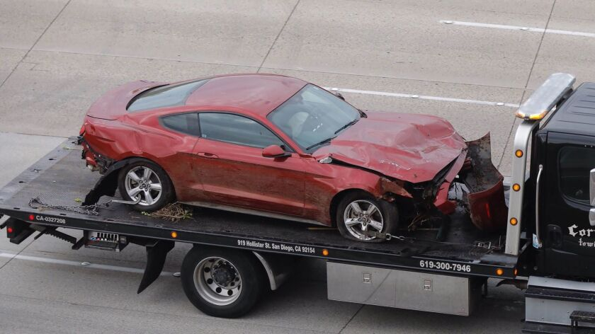 Ford Mustang involved in firey double fatal crash overnight on northbound I-15 south of Miramar Road removed from scene.
