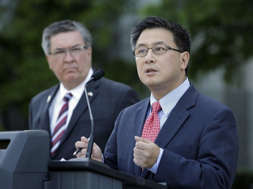 State Treasurer John Chiang, right, calls for passage of a bill by Assemblyman Ken Cooley, D-Rancho Cordova, left, to require all public pension funds to publicly disclose the fees paid to alternative investment vehicles, at a news conference Tuesday, May 31, 2016, in Sacramento, Calif. The Assembl
