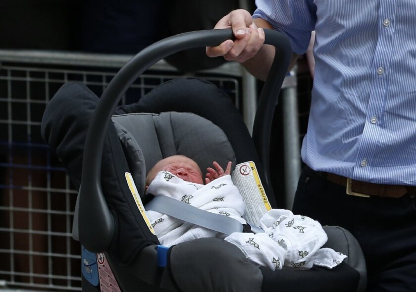 Prince William carries His Royal Highness Prince George of Cambridge into a waiting car. A lot of people -- and especially new parents -- noticed that the baby was not strapped properly into his car seat.