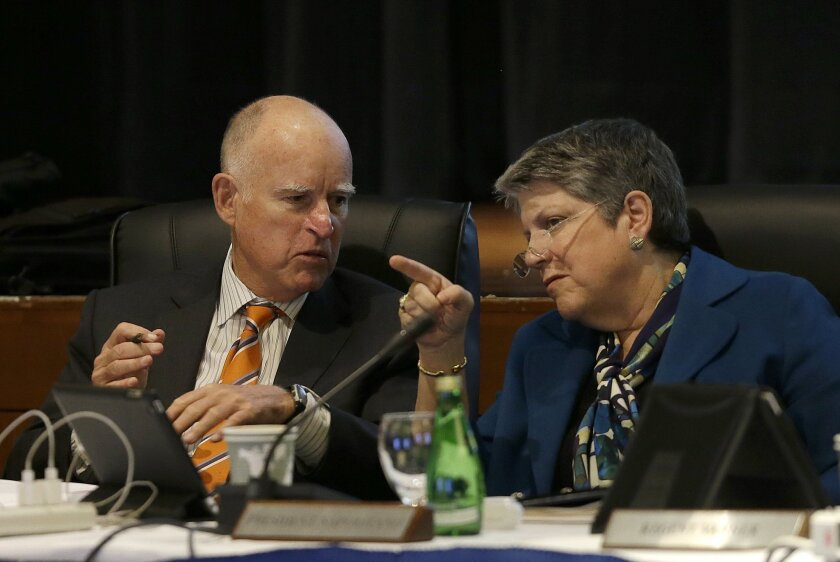 Gov. Jerry Brown talks with University of California president Janet Napolitano during a UC Board of Regents meeting in San Francisco on March 18.