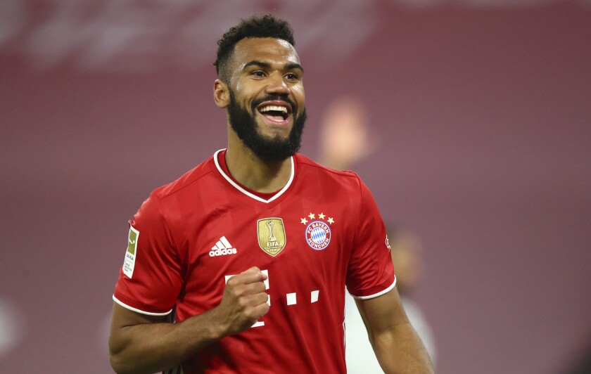 FILE - In this Tuesday, April 20, 2021 file photo, Bayern's Eric Maxim Choupo-Moting celebrates a goal that was disallowed for offside during the German Bundesliga soccer match between Bayern Munich and Bayer Leverkusen at the Allianz Arena stadium in Munich, Germany. Choupo-Moting has signed a two-year contract extension. That cements his status as the backup to Robert Lewandowski. Choupo-Moting joined Bayern in October on a free transfer for one season after his contract with Paris Saint-Germain expired. (AP Photo/Matthias Schrader, Pool, File)