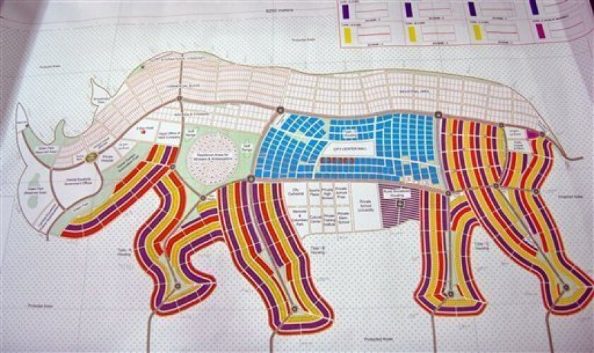 A proposed map of Juba in the shape of an rhino is presented, Wednesday, Aug 18, 2010, in Juba, Southern Sudan. A city shaped like a giraffe? A rhino-shaped town? Even one like a pineapple?Southern Sudan has unveiled ambitious plans to remake its capital cities in the shapes found on their state fl