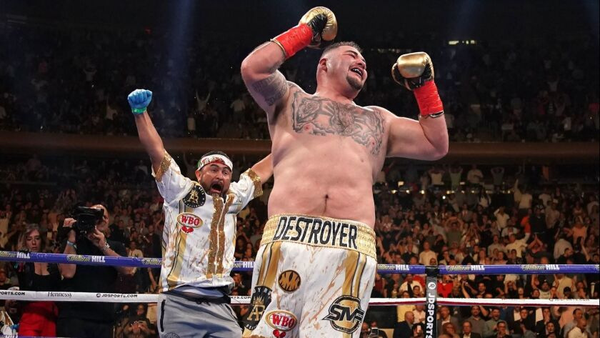Andy Ruiz Jr. celebrates as trainer Manny Robles runs into the ring to join him after his stunning victory over previously unbeaten three-belt heavyweight champion Anthony Joshua on June 1.