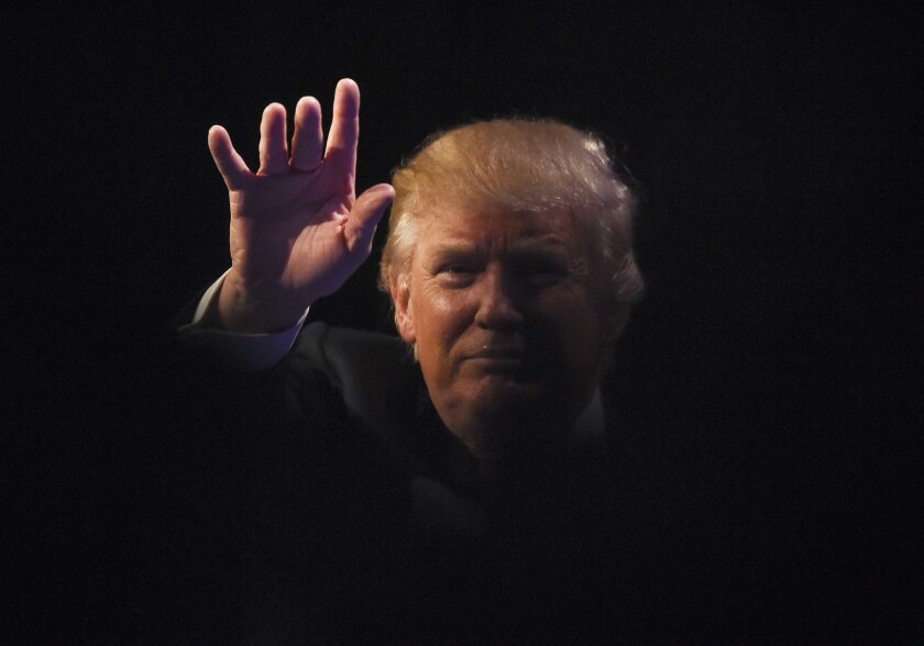 Republican presidential hopeful Donald Trump waves at a rally in Las Vegas on Dec. 14. Trump's recent statements about Muslims are likely to dominate Tuesday's GOP candidate debate.
