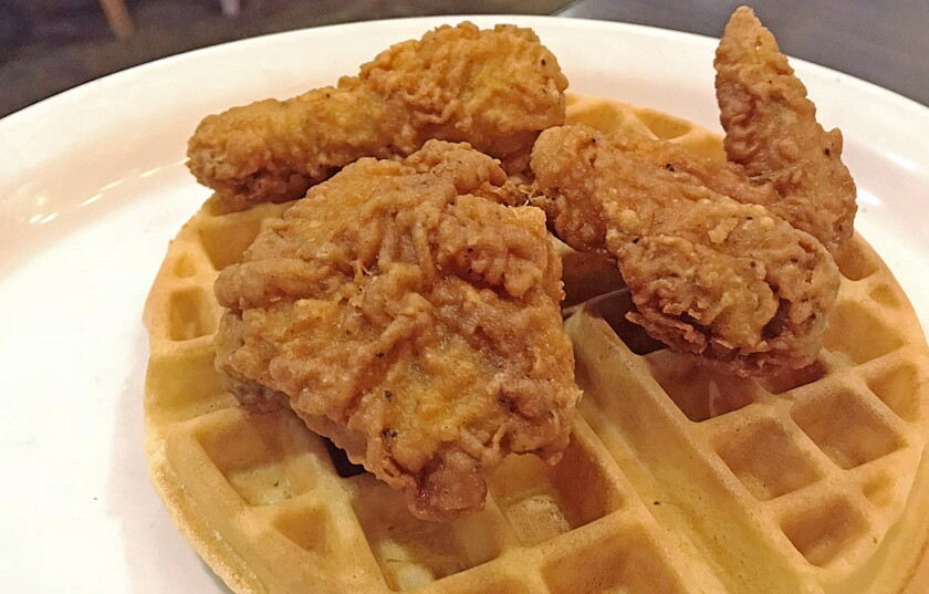The chicken and waffles from Izzy's Deli. (Jenn Harris / Los Angeles Times)