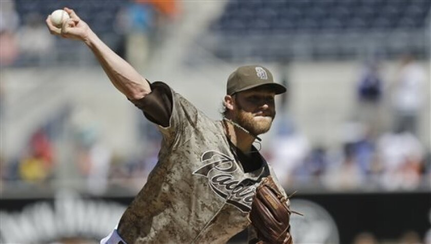 San Diego Padres starting pitcher Andrew Cashner works against the Los Angeles Dodgers in the first inning of an MLB National League baseball game Sunday, Sept. 22, 2013, in San Diego. (AP Photo/Lenny Ignelzi)