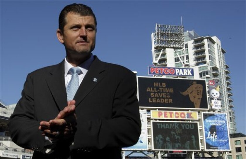 Former baseball pitcher Trevor Hoffman pauses speaking to journalists after announcing his retirement at Petco Park Wednesday, Jan. 12, 2011, in San Diego. Baseball's all-time saves leader announced his retirement at age 43 after 18 seasons in the major leagues. (AP Photo/Gregory Bull)