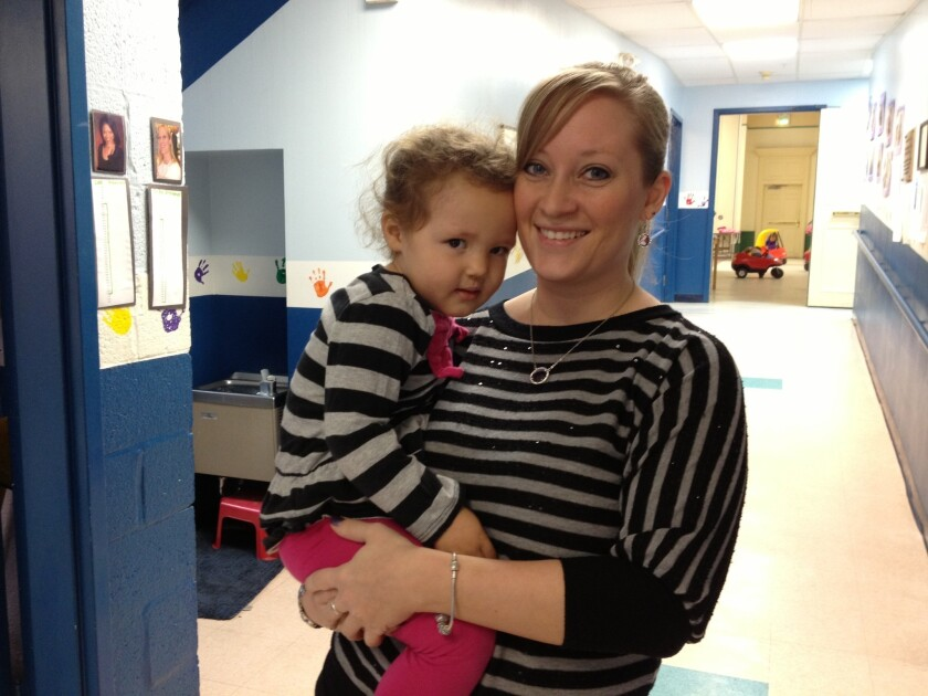 Maryland preschool teacher Erika Brannock, who was among those seriously injured in the Boston Marathon bombings, with one of her students, 2-year-old Meg Riley Ruopp, in February.
