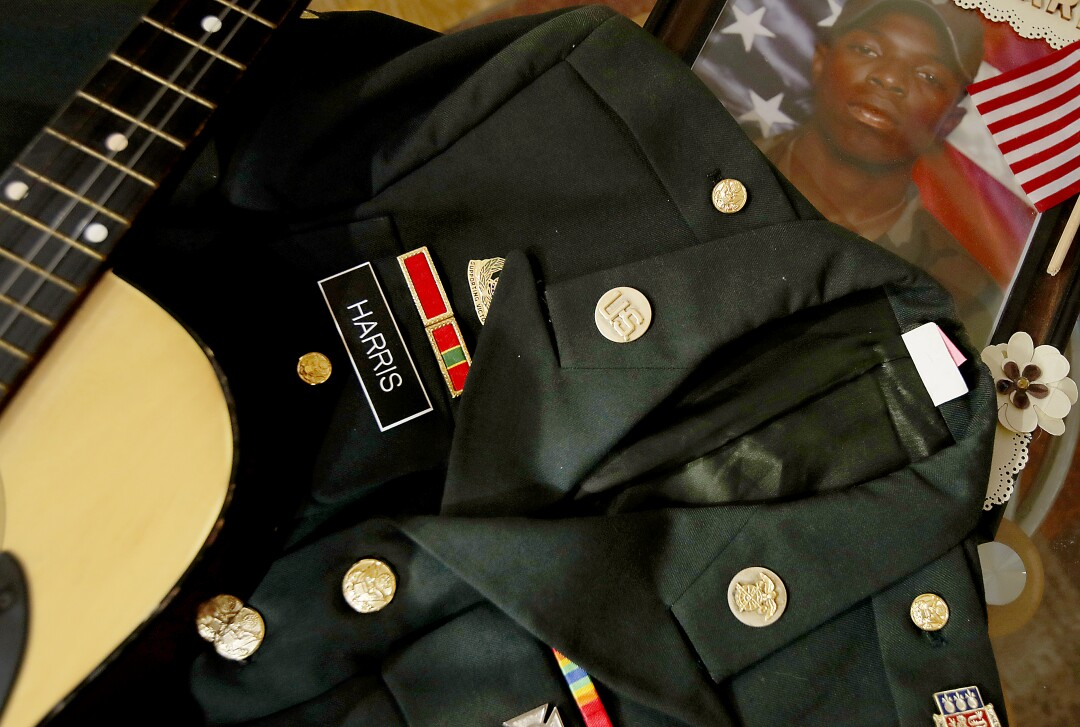 Leroy Harris III's dress uniform jacket, guitar and pictures from his days in the military
