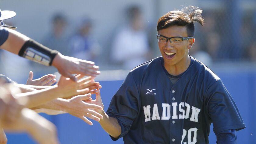 CHULA VISTA, May 24, 2017 | Madison's James Shimashita is congratulated by teammates after he advan
