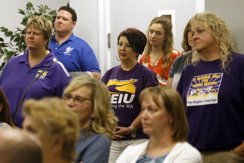HUNTINGTON, WEST VIRGINIA--JULY 6, 2018--A group of teachers from the local teachers' union listen t