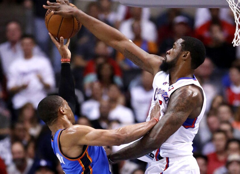 Clippers center DeAndre Jordan blocks a shot by Thunder point guard Russell Westbrook during a game Wednesday at Staples Center.